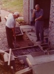 "Ralph Pearce & ""RO"" Miller pouring Larry & Susan's new front entrance July 5, 1976"